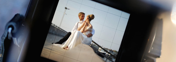 preview of bride and groom on camera