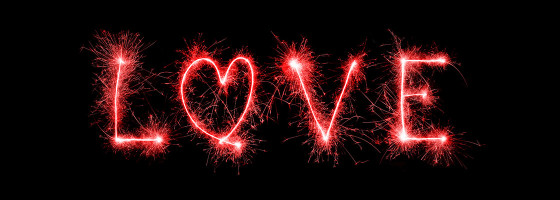 love written with sparklers