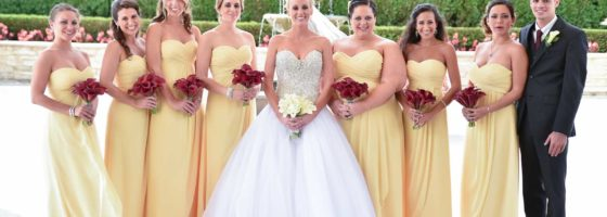 bridesmaids in yellow with red calla bouquets